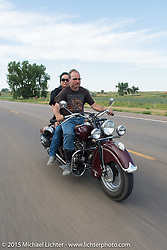 Carolyn and Kiwi Mike Tomas on the annual Lichter/Sugar Bear Ride during the 75th Annual Sturgis Black Hills Motorcycle Rally.  SD, USA.  August 5, 2015.  Photography ©2015 Michael Lichter.