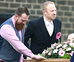 © Licensed to London News Pictures. 10/01/2018. Skipton UK. Malcolm Willshire (right) with the coffin.  The funeral of Jodie Willsher is taking place today at Christ Church in Skipton. Jodie was stabbed to death just before Christmas at an Aldi store in Skipton, 44 year old Neville Hord has been charged with her murder. Jodie's husband Malcolm has asked those attending to wear something pink to remember his wife.Photo credit: Andrew McCaren/LNP