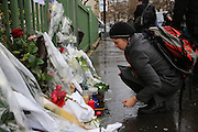 """Flowers, pens, press cards and candles adorn memorial sites on the Richard Lenoir street near to the Charlie Hebdo Offices, in central Paris.<br /><br />French journalists make a vigil in central Paris next to the Offices of Charlie Hebdo, marking one minute silence at midday, to mourn the death of their colleages. Ten staff including journalists, cartoonists and editors at Charlie Hebdo were killed the day before, when armed gunmen attacked the offices of Charlie Hebdo, killing twelve people including two policemen; four more are in critical condition. It is the deadliest terror attack in France for over fifty years. Charlie Hebdo is a satirical publication well known for its political cartoons. The newspaper had been threatened for making satirical images of the prophet Muhammad.<br /><br />As a solidarity action with the deaths at Charlie Hebdo many placards read """"Je suis Charlie"""" translating as """"I am Charlie (Hebdo)"""". Demonstrators hold aloft pens, brushes and crayons, in solidarity for their dead colleagues, symbolizing the profession of journalists and cartoonists who were killed. Many pens and candles have been placed in shrines throughout the city."""