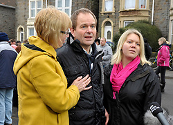 © Licensed to London News Pictures. 03/02/2013. Bristol, UK. Picture of Edwin Simons (centre), father of Ross Simons, and Kelly Woodruff (right) sister of Ross Simons. More than 200 people attend a vigil at the scene where two cyclists, husband and wife Ross and Clare Simons, died after they were involved in a hit and run accident on 27 January with a vehicle in Lower Hanham Road, Hanham, Bristol.  The police have said they tried to flag the vehicle down before the accident because it was going at speed.  People at the vigil were asked to bring cans of Blackthorn cider and Fosters lager, the couple's favourites, and to write messages to the couple.  03 February 2013..Photo credit : Simon Chapman/LNP