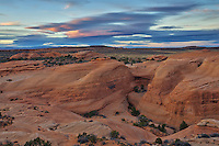 These layers of rock are made out of sandstone and are known as fins. They slowly erode away and form the arches that this national park is known for. This scene was behind the Delicate Arch, looking north at sunset.<br />