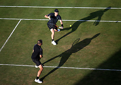Great Britain's Jamie Murray (top) and Brazil's Bruno Soares during day four of the 2017 AEGON Championships at The Queen's Club, London.