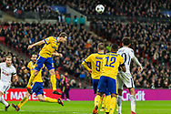 Juventus defender Stephan Lichtsteiner heads the ball clear during the Champions League match between Tottenham Hotspur and Juventus FC at Wembley Stadium, London, England on 7 March 2018. Picture by Toyin Oshodi.