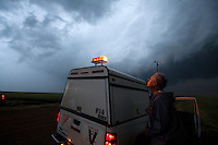 Scientist and Engineer Tim Marshall looks up at a supercell near Last Chance, Colorado, June 10, 2010, while participating in Project Vortex 2, a two year mission to study tornadoes..
