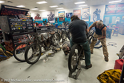 Billy Lane of Chopper's Inc (on bike) with his brother Warren (R) and Berry Wardlaw work on Warren's bike in Billy's shop for Saturday's Sons of Speed Race of nearly century old boardtrack style bikes at New Smyrna Speeday during Daytona Beach Bike Week. FL. USA. Tuesday, March 14, 2017. Photography ©2017 Michael Lichter.