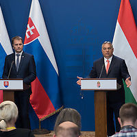 Slovakian prime minister Igor Matovic (L) and Hungarian prime minister Viktor Orban (R) talk during a press conference after their meeting in Budapest, Hungary on June 12, 2020. ATTILA VOLGYI