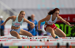 Marina Tomic of Slovenia and Joanna Kocielnik of Poland compete during the first round of the women's 100m hurdles at the 2010 European Athletics Championships at the Olympic Stadium in Barcelona on July 30, 2010. (Photo by Vid Ponikvar / Sportida)