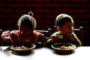 Betim_MG, Brasil...Creche Comunitaria Cantinho Feliz em Betim. Na foto criancas comendo...Cantinho Feliz ommunity nursery in Betim. In this photo children eating...FOTO: LEO DRUMOND / NITRO