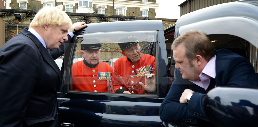 © Licensed to London News Pictures. 02/05/2012. London, UK London Mayor,Boris Johnson(L) is joined bycomedian Al Murray(r )to wave off an army ofWWII veterans who are embarking on an iconic trip to the Netherlands, via a convoy of black cabs.The London Taxi Benevolent Association for the War Disabled has organised a trip for 160 WWII veterans to travel to Holland in 80 London Black Cabs. The veterans, mostly aged between 85 and 94, will start their journey from London today 2nd May 2012 and will be visiting sites of importance from WWII and taking part in Dutch Liberation Day celebrations as guests of honour of the Dutch Royal Family.. Photo credit : Stephen Simpson/LNP