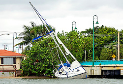 October 7, 2016 - Florida, U.S. - A sailboat rests against the bridge to Singer Island near Phil Foster Park Friday morning, October 7, 2016  after the passing of Hurricane Matthew. (Credit Image: © Lannis Waters/The Palm Beach Post via ZUMA Wire)