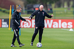 CARDIFF, WALES - Tuesday, March 23, 2021: Wales' care-taker manager Robert Page (R) with assistant coach Albert Stuivenberg (L) during a training session at the Vale Resort ahead of the FIFA World Cup Qatar 2022 Qualifying game against Belgium. (Pic by David Rawcliffe/Propaganda)