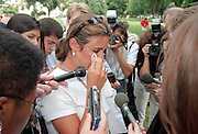 School teacher Jillian Simon (C), of Wilmington, NC talks with reporters in front of the US Capitol after witnessing the shooting that erupted on Capitol Hill July 24, 1998 in Washington, DC. Two US Capitol police officers were killed in the incident, one person wounded and the lone gunmen was wounded and taken into custody.
