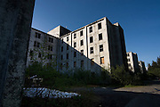 """The Buckner Building, Whittier, Alaska - """"A city under one roof"""". Built in 1953, this derelict building was abandoned but can't be demolished due to the amount of asbestos inside. It was damaged by earthquake in  1964.....The strangest town in Alaska, Whittier - only reachable by tunnel or ship. It's a stop off point for Cruise ships, and the Alaska raildroad. 90% of inhabitants live in one building! Originally established as a military base during World War two....."""