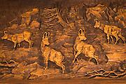 Wood carving of mountain goats, Risnjak National Park, Croatia