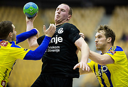 Mitja Nosan of RK Gorenje between Miha Zarabec of RK Celje PL and Povilas Babarskas of RK Celje PL during handball match between RK Celje Pivovarna Lasko and RK Gorenje Velenje in Eighth Final Round of Slovenian Cup 2015/16, on December 10, 2015 in Arena Zlatorog, Celje, Slovenia. Photo by Vid Ponikvar / Sportida