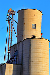 2018 corn and soybean harvest in Central Illinois.  Crops are delivered to and stored in various types of grain bins, silos and grain elevators made of steel, concrete and sport different kinds of scaffolding, augers and tubing to move and deliver the grain. Some images in this series have been digitally altered.  <br /> <br /> Some images in this series may not be available for sale or licensing