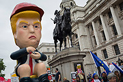 On US President Donald Trump's second day of a controversial three-day state visit to the UK, a Trump effigy tweets while sitting on a golden toilet as protesters voice their opposition to the 45th American President, in Whitehall, on 4th June 2019, in London England.