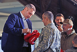 October 2, 2018 - Kiev, Ukraine - Former heavyweight boxing champion and current Mayor of Kiev VITALI KLITSCHKO (L) presents his signature to Ukrainian soldiers participated fighting in the eastern Ukraine, during an authographs session for supporters at the 56th World Boxing Convention in Kiev, Ukraine, on 2 October 2018.The WBC 56th congress in which take part boxing legends Evander Holyfield,Lennox Lewis, Eric Morales and about 700 participants from 160 countries runs in Kiev from from September 30 to October 5. (Credit Image: © Serg Glovny/ZUMA Wire)