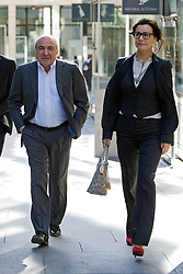 **CAPTION CORRECTION** © London News Pictures. 31/08/2012. London, UK. Russian Oligarch Boris Berezovsky (left) arriving at The Royal Courts Of Justice with his girlfriend Yelena Gorbunova (right) on August 31, 2012 where a judge has ruled AGAINST BEREZOVSKY in a  £3.2 billion lawsuit over Abramovich's £10.3 billion fortune. Photo credit: Ben Cawthra/LNP