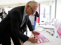 © Licensed to London News Pictures. 10/10/2013. London, UK. Norman Lamb, the Care and Support Minister, signs a pledge at a Parliamentary reception hosted by mental health charities 'Time to Change', 'Mind' and 'Rethink Mental Illness' in London today (10/10/2013). The event held on 'World Mental Health Day' saw the Deputy Prime Minister, Nick Clegg, and the Care and Support Minister, Norman Lamb, joined by cross party MP's and peers, reinforce the need to tackle the stigma and discrimination surrounding mental health problems.  Photo credit: Matt Cetti-Roberts/LNP