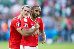 PARIS, FRANCE - Saturday, June 25, 2016: Wales' Gareth Bale hugs Ashley Williams as they celebrate victory against Northern Ireland during the Round of 16 UEFA Euro 2016 Championship match at the Parc des Princes. (Pic by Paul Greenwood/Propaganda)