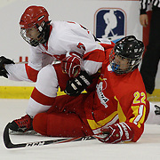 Peng Ji, China and Dogu Bigol, Turkey, clash during the China V Turkey match during the 2012 IIHF Ice Hockey World Championships Division 3 held at Dunedin Ice Stadium. Dunedin, Otago, New Zealand. 19th January 2012. Photo Tim Clayton