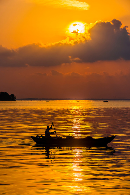 A fisherman rowing his boat at sunrise, Kinniya (near Trincomalee), Eastern Province, Sri Lanka.