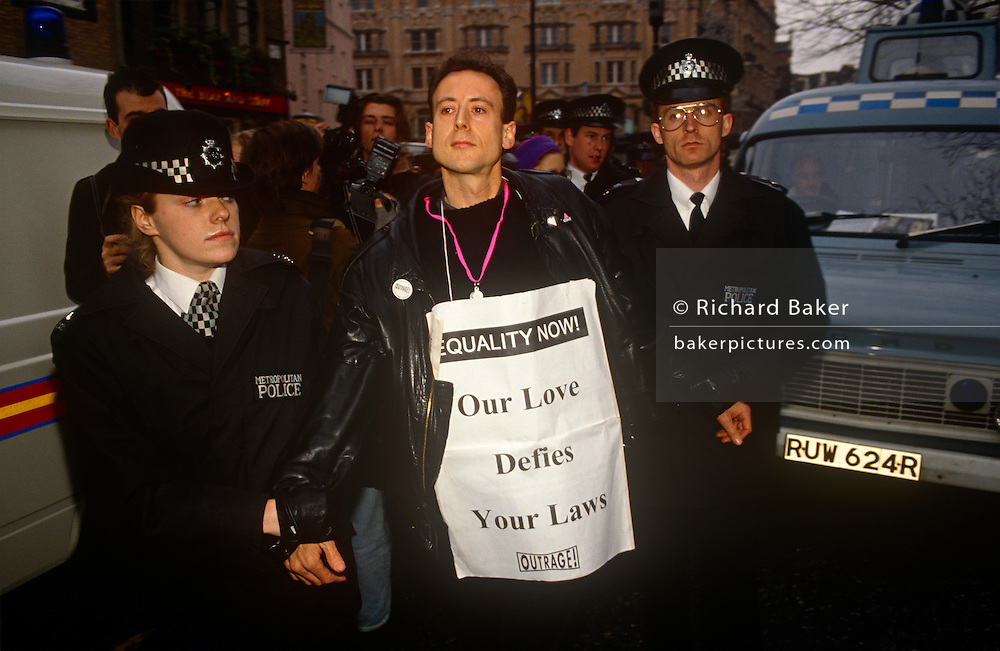 Gay-rights activist Peter Tatchell is arrested by police officers at an Outrage protest on 6th February 1992 in London England.