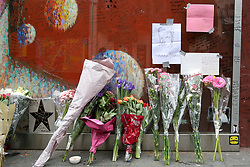 © Licensed to London News Pictures. 10/01/2019. London, UK. Flowers and tributes are placed on a mural and shrine to David Bowie in Brixton, on the third anniversary of his death. Photo credit: Dinendra Haria/LNP