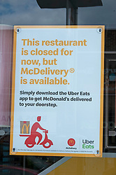 ©Licensed to London News Pictures 13/05/2020<br /> Welling, UK. Welling McDonalds in South East London has queues of food delivery drivers outside waiting some with protective masks on. Some McDonalds restaurants in the UK have opened today from 11am for McDelivery service only after being closed for weeks due to the Coronavirus lockdown. Photo credit: Grant Falvey/LNP
