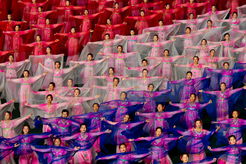 © Licensed to London News Pictures. 10/08/2011. Pyongyang, North Korea. Thousands of volunteers perform synchronised dancing as part of the Arirang Mass Games in Pyongyang.  The 100,000 performers train for up to three years before being ready to perform at the event which takes place nightly for around two months in summer each year. Photo credit : James Gourley/LNP/