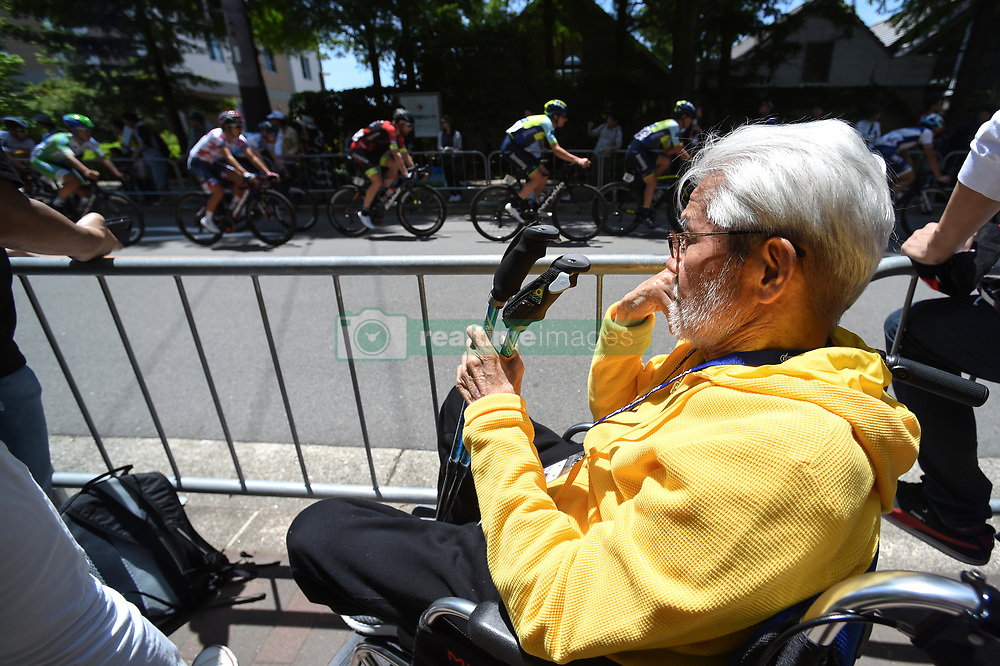 May 20, 2018 - Sakai, Osaka, Japan - Yoshizo Shimano, a former President of Shimano Inc., watches the warm up criterium race ahead of the opening stage, 2.6km Individual Time Trial in Daisen Park, Sakai..On Sunday, May 20, 2018, in Sakai,  Osaka Prefecture, Japan. (Credit Image: © Artur Widak/NurPhoto via ZUMA Press)