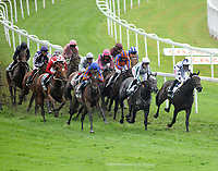 Horse Racing - 2021 Epsom Festival - The  Oaks Friday - Epsom Downs <br /> <br /> Winner, Snowfall (Frankie Dettori) (Purple cap ) sits at the back of the field at  Tattenham corner<br /> <br /> <br /> Credit : COLORSPORT/ANDREW COWIE