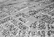 Ackroyd 04054-11. Woodlawn Elementary School, between NE 11th and 12th at NE Buffalo. large building in upper center is Sunshine Biscuits, 1313 NE Lombard. December 13, 1952