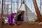 Tsaatan reindeer herder family in front of their teepee, Khovsgol Province, Mongolia