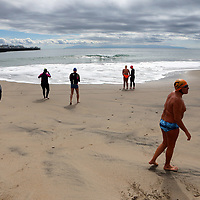 Swimmers from Santa Cruz Masters head to the chilly Monterey Bay waters from Cowell Beach on Wednesday for an open water swim. (Shmuel Thaler — Santa Cruz Sentinel)