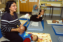Baby massage class at NHS clinic run by Community Health Worker Bradford Yorkshire UK