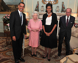US President Barack Obama and his wife, Michelle, talk with Queen Elizabeth II and the Duke of Edinburgh during an audience at Buckingham Palace in London.