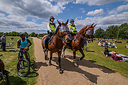"""Police horse patrol the picnic - A so called 'Mass' Gathering takes place in Hyde Park as a small group of protestors say no to the """"coronavirus bill"""" and no to the """"unlawful lockdown"""", as they fear for their freedom during the coronavirus pandemic. The protest was outnumbered by police and journalists and attracted people against vaccination, 5G, Bill Gates, paedophiles, tracking and many other things. The 'lockdown' continues for the Coronavirus (Covid 19) outbreak in London."""
