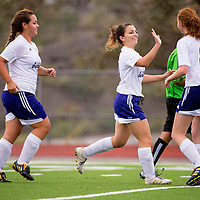 090913       Brian Leddy<br /> Miyamura Patriot Baylee Schmaltz (9) gets a high five from her teammates after scoring a goal against the Bloomfield Bobcats during Monday's game at Public School Stadium.