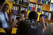 Juliane Rey-Bellet.Juliane.REY-BELLET@admin.vs.ch.+41787445914..Juliane teaching franch to immigrants waiting for Suisse citizenship, at Vetroz school.