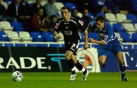 Photo: Daniel Hambury.<br /> Reading v Swansea. Carling Cup.<br /> 23/08/2005.<br /> Reading's Nicky Shorey chases Swansea's Leon Britton