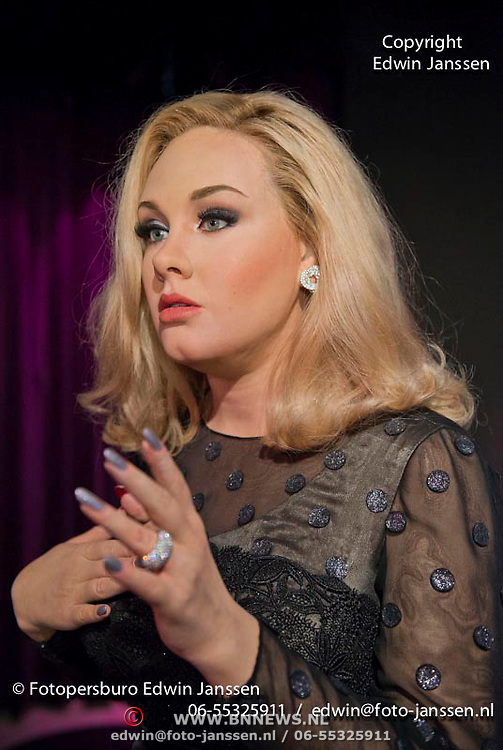 Amsterdam, 03-07-13. Het wassen beeld van de met prijzen overladen singer-songwriter Adele is vanmorgen onthuld in Madame Tussauds door Angela Groothuizen. Foto: Het zojuist onthulde wassen beeld van Adele
