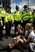 School children on school strike marching in protest against the governments in-action on climate change, May 24th 2019, Central London, United Kingdom. The protest is part of a global protest inspired by the Swedish climate activist Greta Thundberg who went on strike for the climate. The protest was energetic and peaceful with  some children blocking the road in Parliament Square. Two were subsequently detained by police.