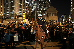 Police stop anti-Donald Trump protesters from attempting to cross the North Wabash Avenue bridge in downtown Chicago, IL, USA, on Wednesday, November 9, 2016. Photo by Armando L. Sanchez/Chicago Tribune/TNS/ABACAPRESS.COM