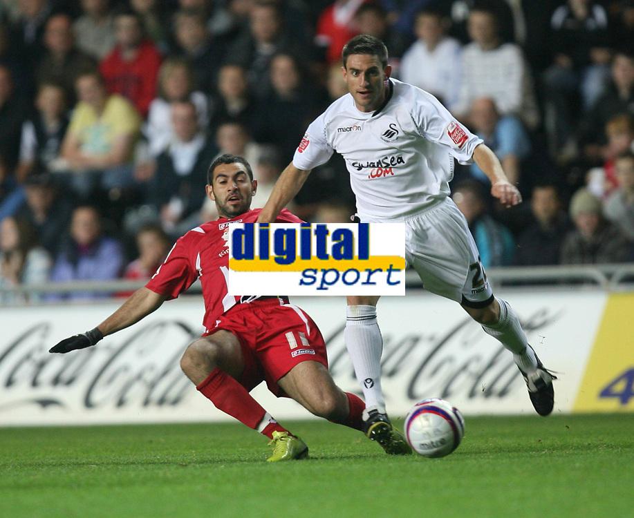 Photo: James Davies.<br />Swansea City v Swindon Town. Coca Cola League 1. 02/10/2007. <br />Swindon`s Sofiene Zaaboub gets ball away under pressure from Angel Rangel.