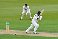 Rilee Rossouw of Hampshire hits the ball to the boundary for four runs during the first day of the Specsavers County Champ Div 1 match between Hampshire County Cricket Club and Essex County Cricket Club at the Ageas Bowl, Southampton, United Kingdom on 5 April 2019.