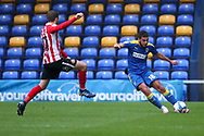 AFC Wimbledon defender Nesta Guinness-Walker (18) passing the ball up the line during the EFL Sky Bet League 1 match between AFC Wimbledon and Sunderland at Plough Lane, London, United Kingdom on 16 January 2021.