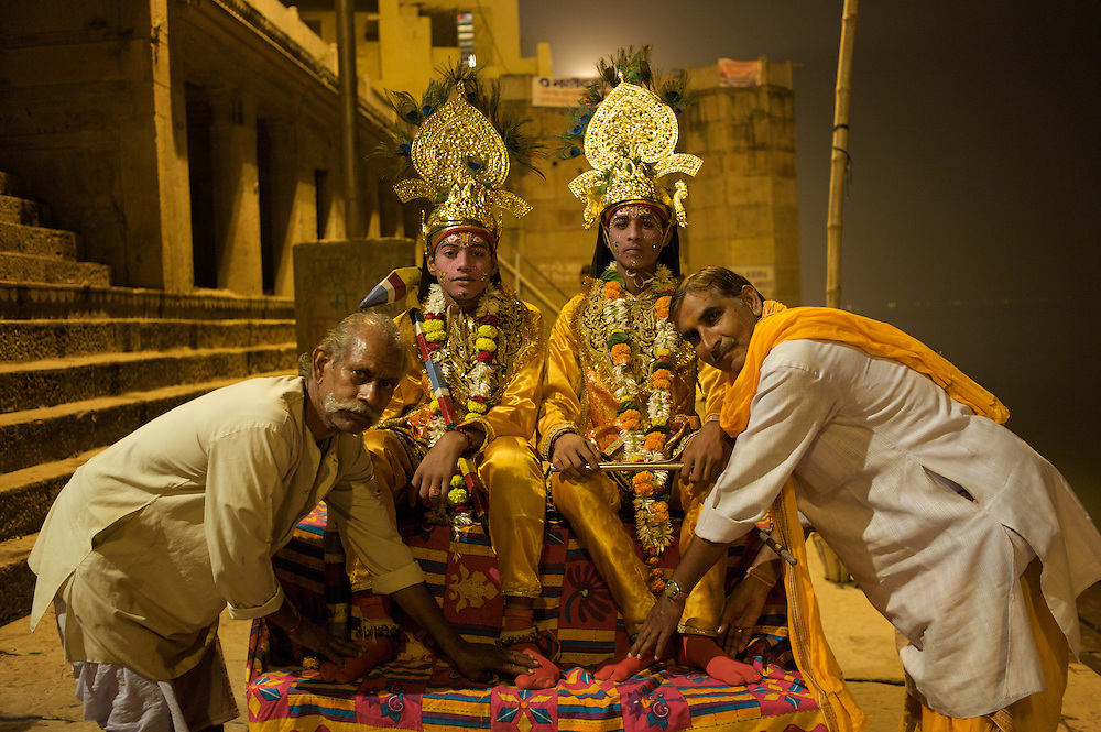 The Ram Lila, which reenacts the Hindu epic the Ramayana, typically presented over a 10-day period in the fall. Here, two grown men show respect to the boys who portray Hindu gods.