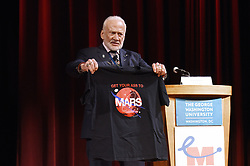 """Astronaut, Gemini XII & Apollo XI Buzz Aldrin holds a T-Shirt """"Get your ass to Mars""""during the Humans 2 Mars Summit at the George Washington University in Washington, DC, on May 9, 2017. Photo by Olivier Douliery/ Abaca"""
